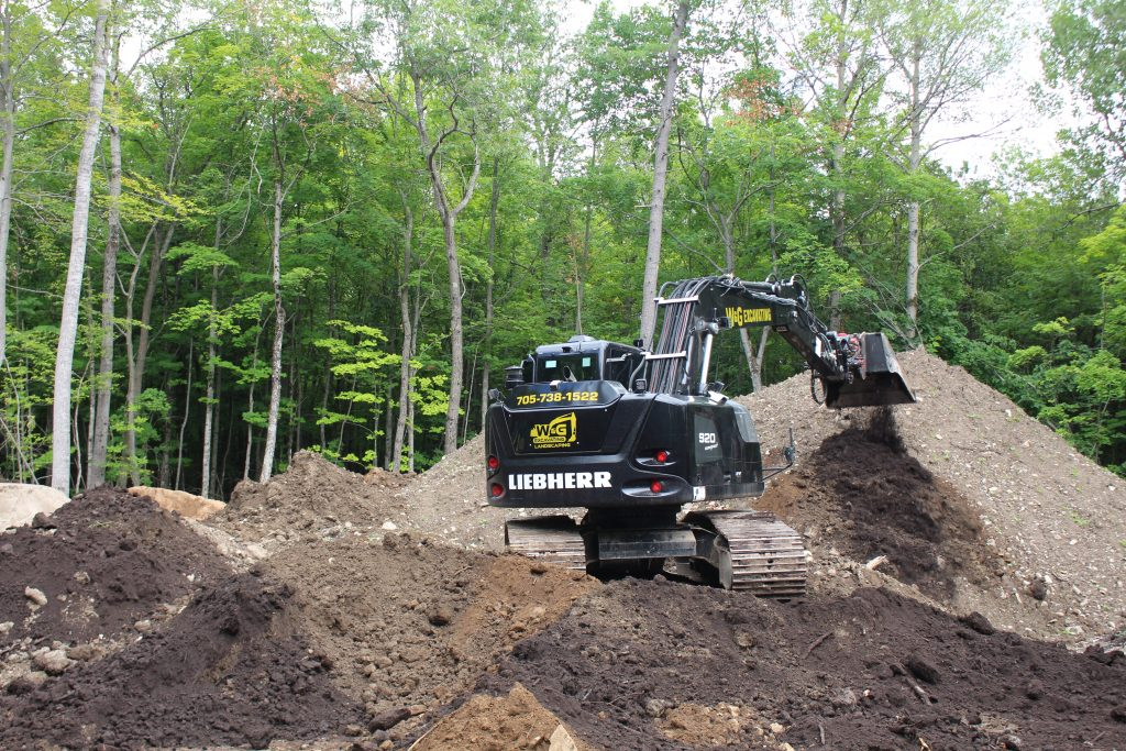 Liebherr 920 compact excavator in action, moving soil