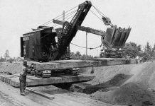 1921 Marion Model 21 placing large wooden planks attached by chains to bucket