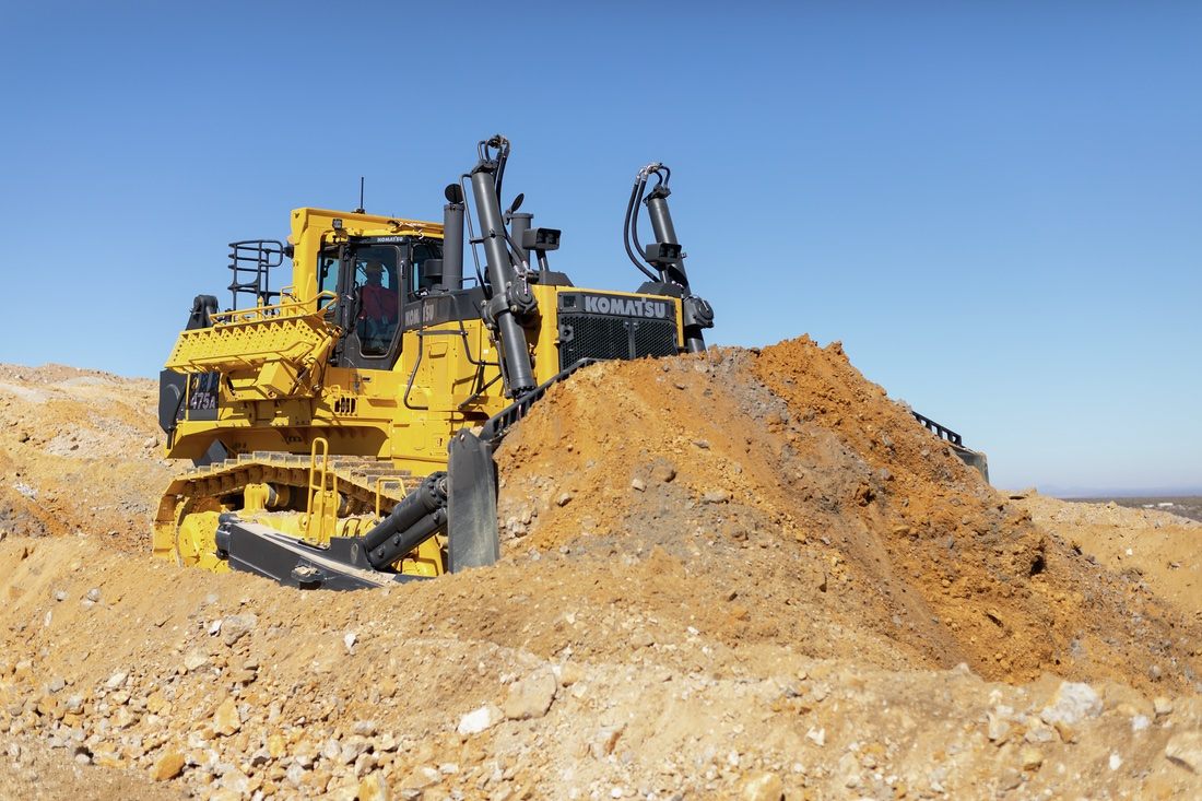 Komatsu D475A-8 pushing material with its blade