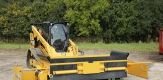 Road Widener's FH attachment mounted to a compact track loader