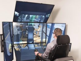 Person sitting in simulator, operating machinery