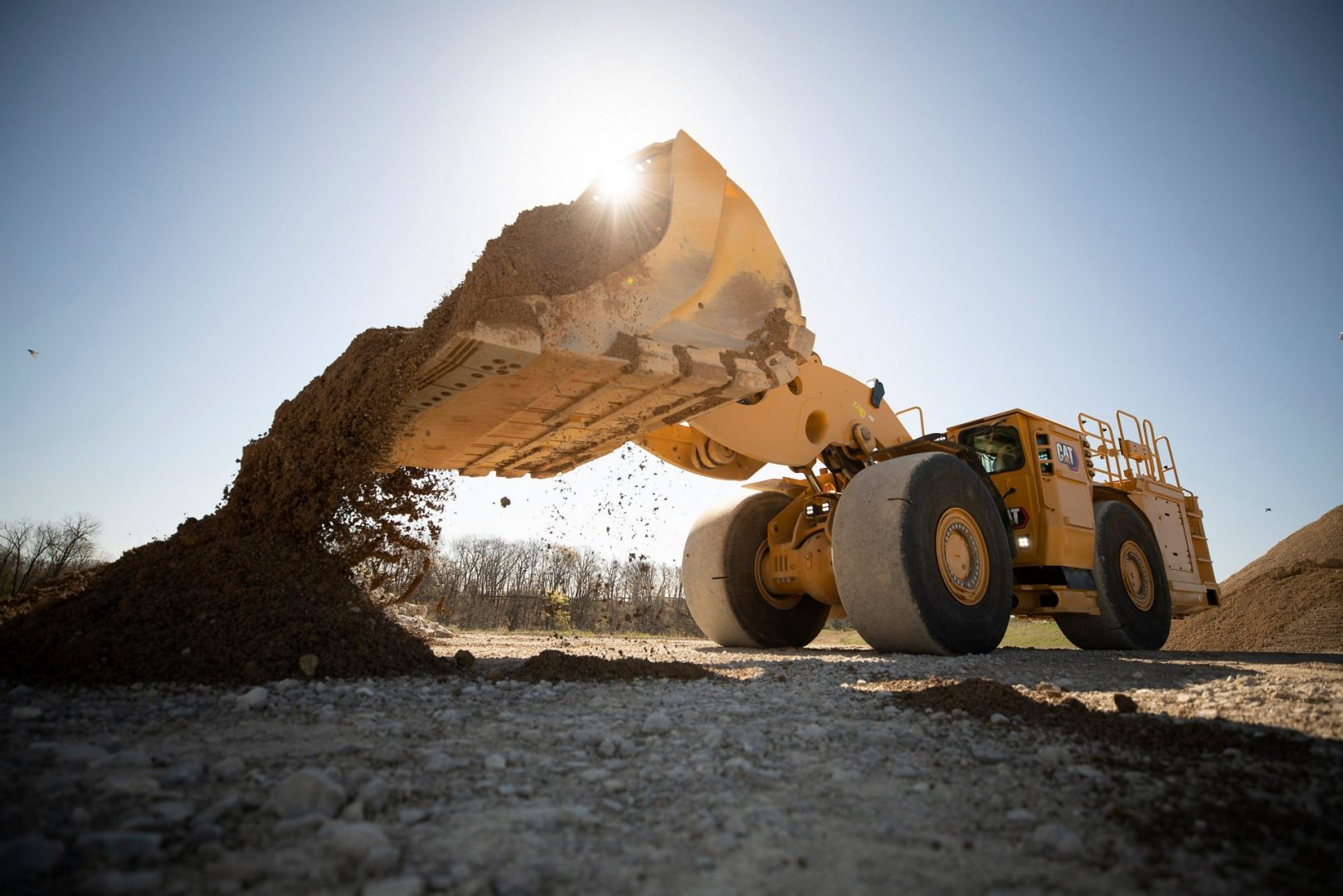 The R1700 XE dumping a bucket of material.