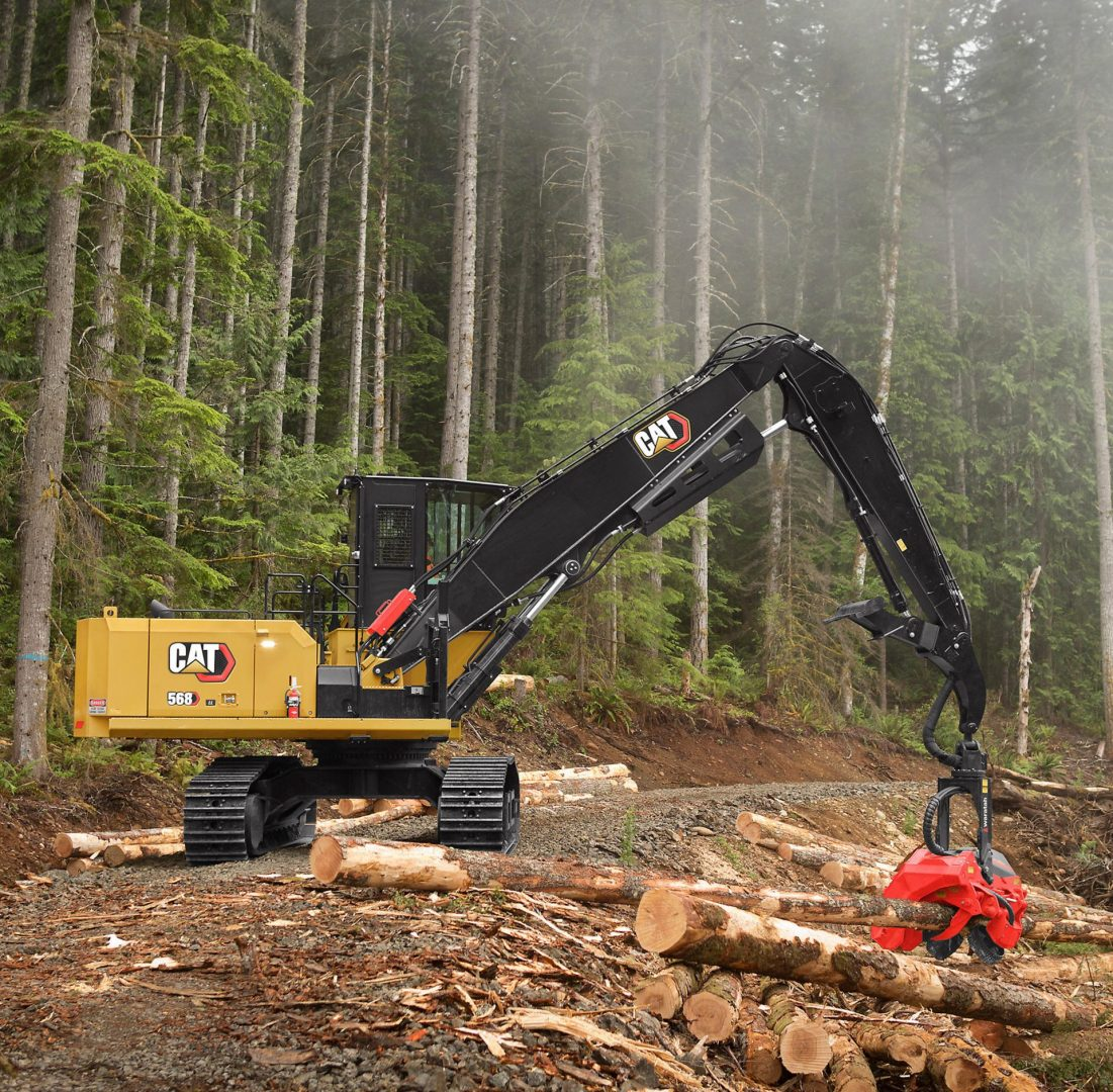 Side profile of a CAT 568 as it picks up a log.
