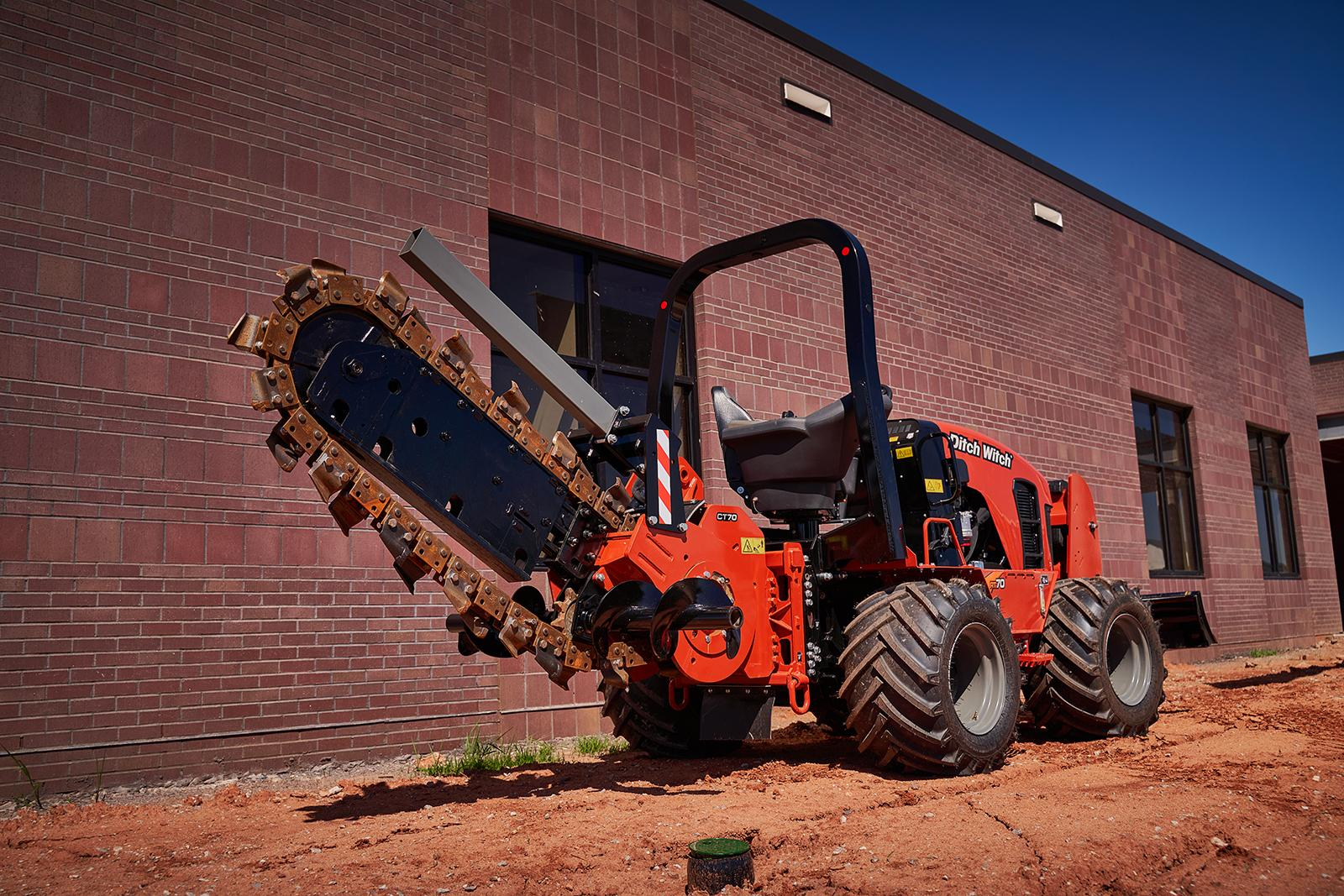 Ditch Witch's new RT70 with its blade raised.
