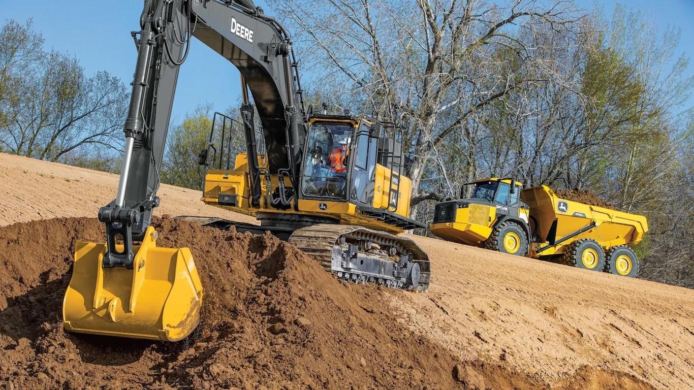 John Deere 470G digging on a job site.