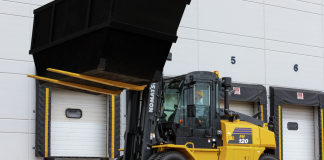 Komatsu FH Series forklift lifting a bin.