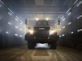 A Rokbak hauler shines its headlights at the camera and shows off its new look.
