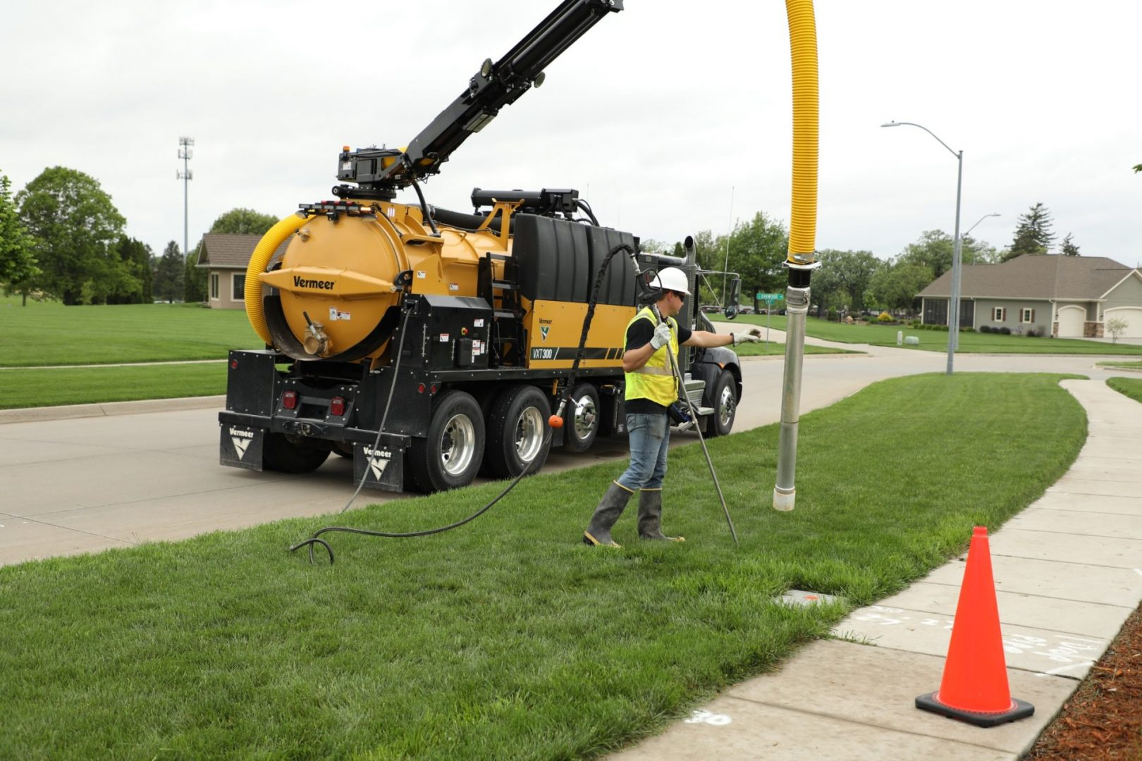 Vermeer VXT300 truck-mounted vacuum excavator in use in a suburban neighbourhood